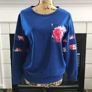 Tops - Blue pull over with floral pocket details